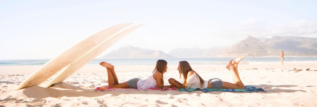 two girls relaxing on a beach