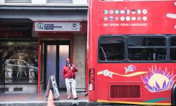 Cape_town_tourism_info_center_long_street_with_city_sightseeing_bus_craig_howes