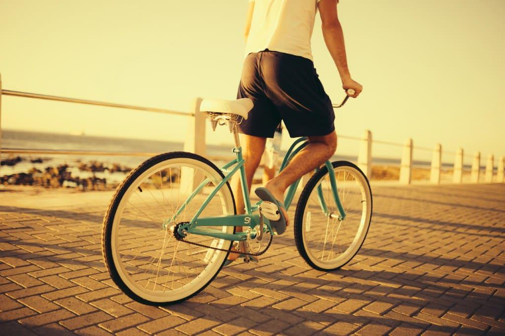 a cyclist on the Sea Point Promenade.