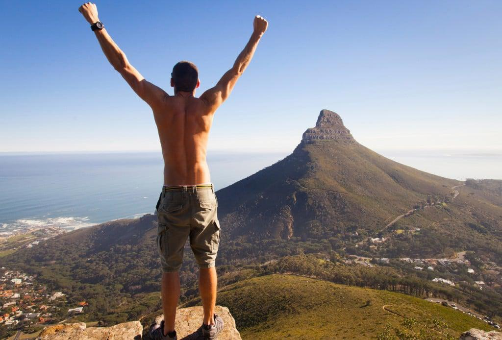 hiker_without_shirt_on_top_of_table_mountain