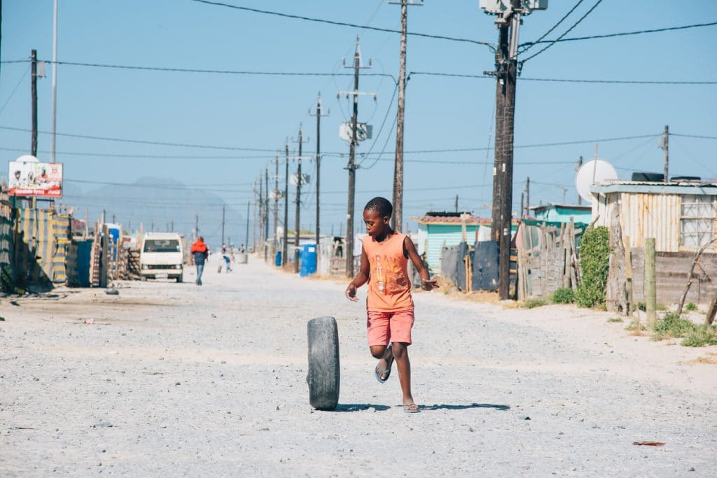 Khayelitsha boy with tyre