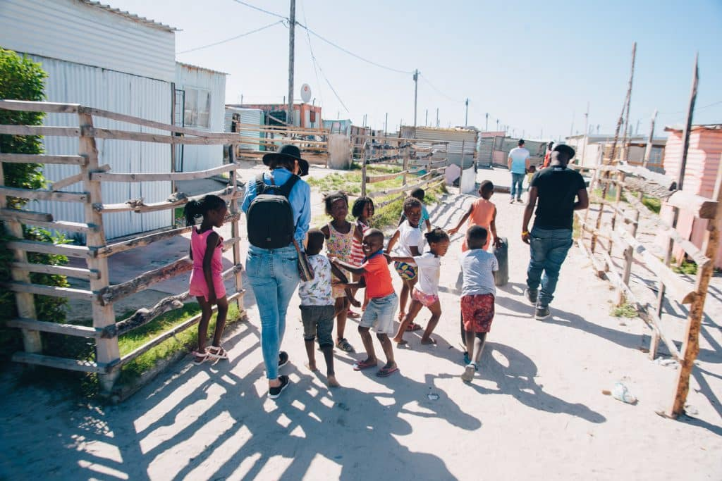 Tourist with children in Khayelitsha