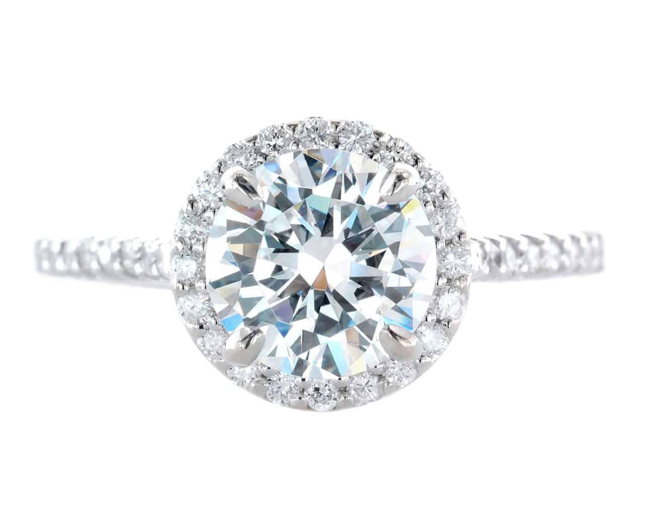 A platinum wedding ring with a round brilliant-cut center diamond