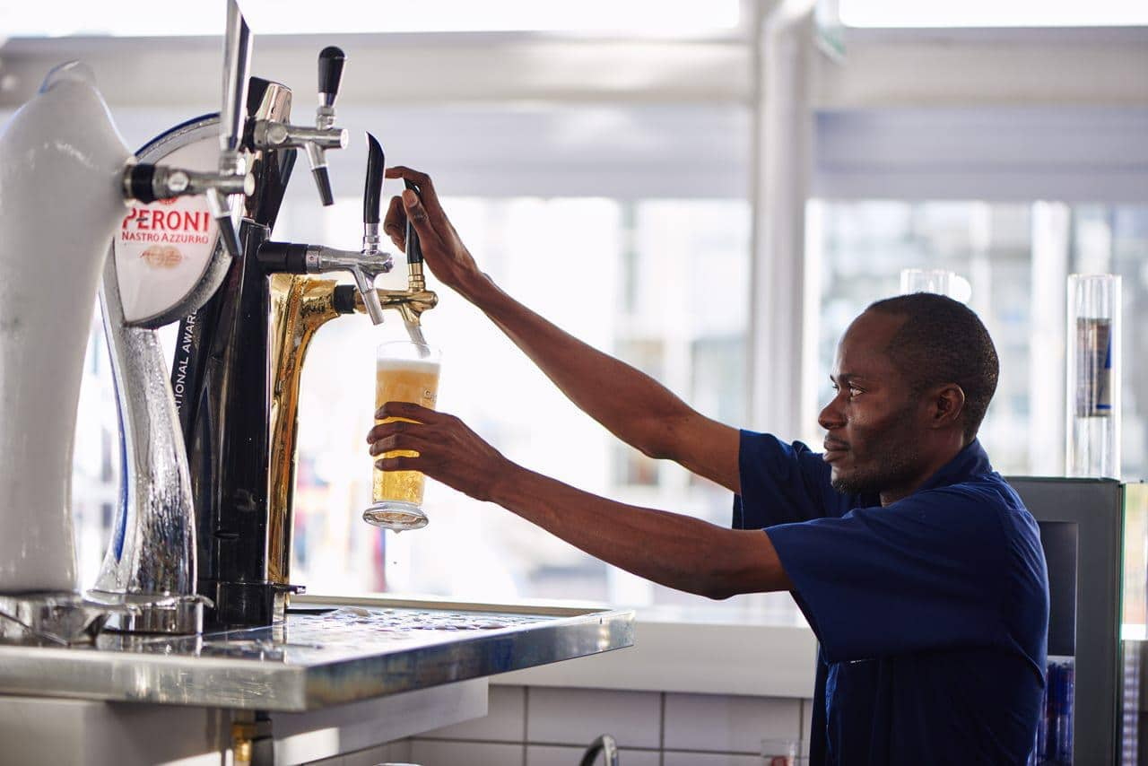 Cape_Town_barman_pouring_beer