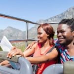 hello weekend couple on city sightseeing bus cape town istock