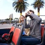 tourists_taking_photos_on_sighseeing_bus_cape_town