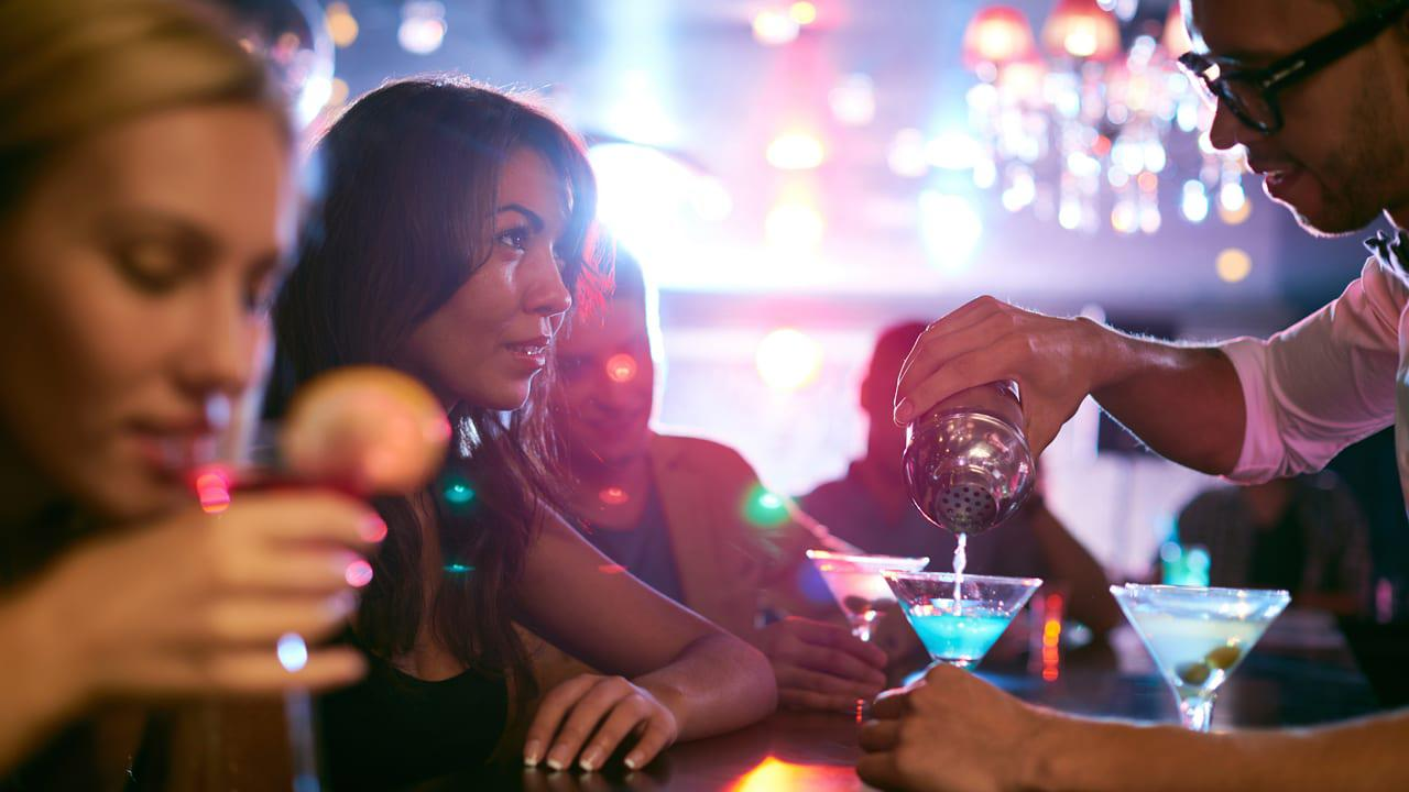 women drinking at the bar