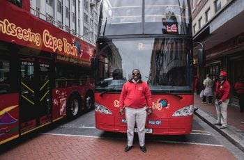City_sightseeing_driver_in_front_of_bus_craig_howes.jpg
