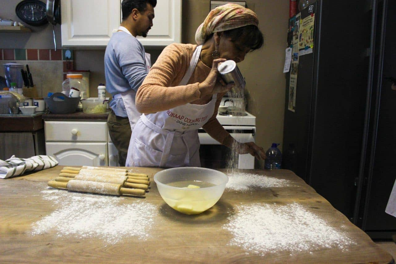 Zainie Misbach pours flour on a table on the Bo-Kaap cooking tour
