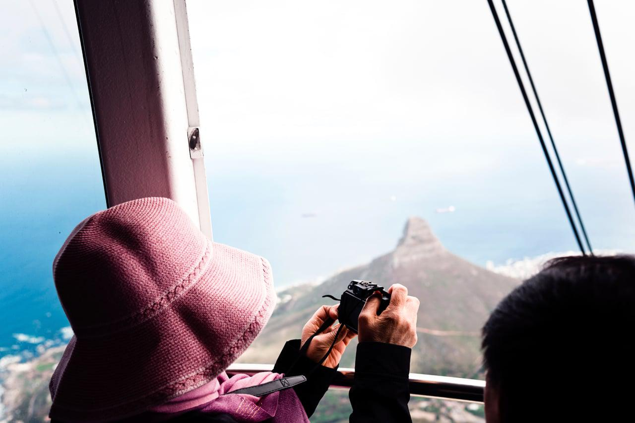 Tourist on aerial cableway in Cape Town.